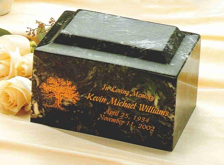 A black urn box with orange lettering.
